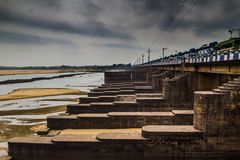 Dam barrage in durgapur city landscape with flood gates closed clowdy scene HDR. Dam barrage in durgapur city landscape with floodgates closed clowdy scene HDR stock photography