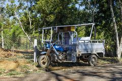 Custom made blue three wheel vehicle in Dam Bri, Vietnam. DAM BRI, VIETNAM - FEBRUARY 19, 2018: Custom made blue three wheel vehicle in Dam Bri, Vietnam stock image