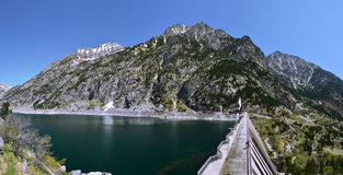 Dam of Cavallers Lake in Alta Ribagorca of Catalan Pyrenees royalty free stock photography