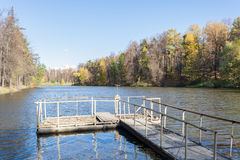 Dam on a city pond in sunny autumn day Stock Photo