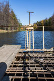 Dam on a city pond in sunny autumn day Royalty Free Stock Photos