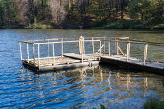 Dam on a city pond in sunny autumn day Stock Photography