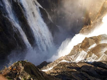 Dam of Contra Verzasca, spectacular waterfalls Stock Photography