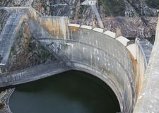 Dam Wall and Dam with Low Water Level. A dam and dam wall in South Africa with low water levels due to drought Stock Image