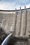 Dam draining water Stock Photo