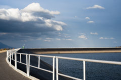 Dam in early spring evening, water surface and fen Stock Photography