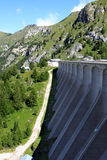 Dam of Fedaia Reservoir in the Italian Dolomites. At the Fedaia Pass in the mountains of Dolomites in Italy you can find the storage reservoir Fedaia Lake Stock Photo