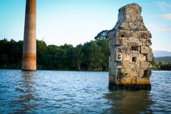 Dam flooded ancient buildings and trees Stock Image