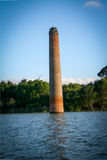 Dam flooded ancient buildings and trees Stock Photography