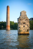 Dam flooded ancient buildings and trees Stock Photos