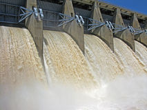 Dam floodgates open. Ed wide for the spring runoff royalty free stock photo