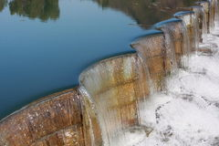 The dam with flowing water Stock Images