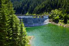 Dam on the Galbenu lake Stock Photography