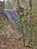 Dam at Hanging Rock State Park. Water from the lake spills over the dam at Hanging Rock State Park in Danbury, North Carolina royalty free stock photos