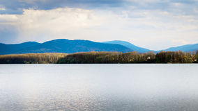 Dam and hills. Zermanice Dam (Czech republic) and the Beskydy mountains on background Stock Photo