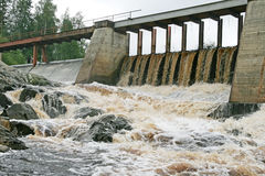 Dam of a hydroelectric power station. On a karelian river, Russia Stock Photos