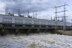 Dam hydroelectric power station during the discharge of flood waters. Dam hydroelectric power station on the river during the discharge of flood waters Stock Photos