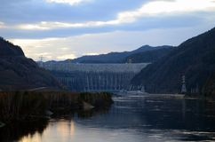 Dam and hydroelectric power station. Wide, powerful, big river Yenisei river. royalty free stock image