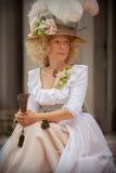 Dam i viktoriansk klänning royaltyfria bilder