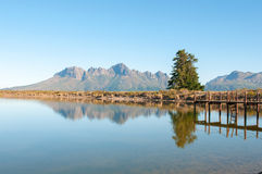 Dam with jetty with the Helderberg in the background Stock Photography