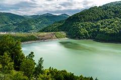 Dam lake between mountains Royalty Free Stock Photography