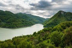 Dam lake between mountains Stock Images