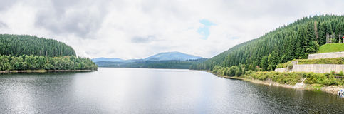 The dam and lake Oasa, river Sebes, pine forests, Sureanu Mounta Royalty Free Stock Photo
