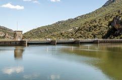Dam on a lake Royalty Free Stock Image