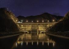 Dam lake under starry night sky. Night image royalty free stock photo