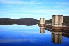 Lake reflecting dam landscape Royalty Free Stock Photo