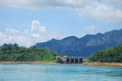 Dam between mountain. This is a dam in a large green lake in surat south of thailand Stock Image