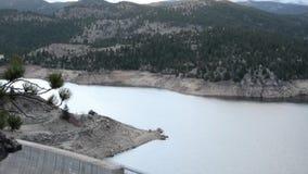 Dam on mountain reservoir stock video