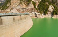 Dam between mountains with green lake at Kurobe dam  japan Royalty Free Stock Images