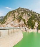 Dam between mountains with green lake at Kurobe dam  japan Royalty Free Stock Photography