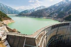 Dam between mountains with green lake at Kurobe dam  japan Stock Photo
