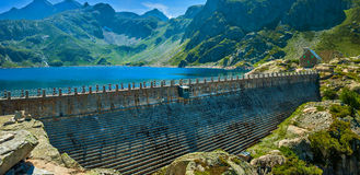 Dam on mountains top Stock Images