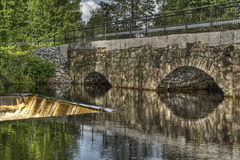 Dam and old stone bridge of the hydroelectric power station in HDR Stock Image