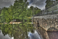 Dam and old stone bridge of the hydroelectric power station in HDR Royalty Free Stock Photos