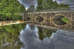 Dam and old stone bridge of the hydroelectric power station in HDR Royalty Free Stock Photography