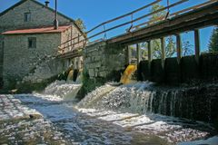 Dam at the old water mill made of stones. stock photo