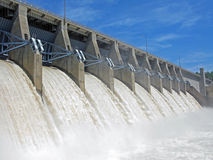 Dam with open spillway. Dam releasing spring rain with all its floodgates opened stock images