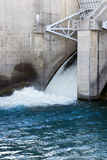 Dam overflow gates with blue water Royalty Free Stock Photo