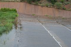 DAM OVERFLOW. Water running down tiered slope royalty free stock photography