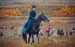 Dam på Häst-jakt royaltyfri foto