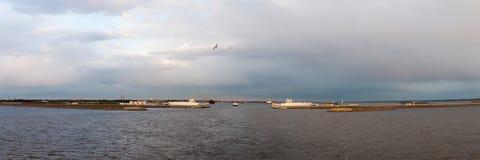 Dam panorama in St. Petersburg in autumn evening. Dam panorama in the Gulf of Finland at St. Petersburg in autumn clear evening Royalty Free Stock Image