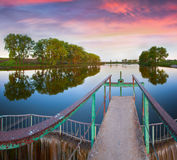 Dam on the pond. Summer morning Stock Image