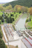 Dam power industry. Image of  a dam generating electricity with rushing water Stock Image
