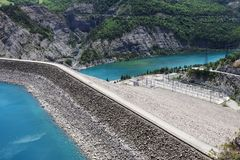 Dam and Power station, Lake Serre-Poncon, French Hautes-Alpes. Lac de Serre-Poncon is a lake in southeast France and one of the largest artificial lakes in royalty free stock photo