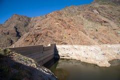 Dam- Presa Del Parralillo. Reservoir Dam - Presa Del Parralillo in mountains, altitude 53 m in Gran Canaria, Spain stock images