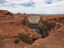 Dam and red rocks. royalty free stock photo